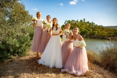Bridesmaids and bride at the riverside in rustic Portugal