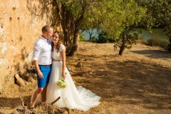 Bride and groom photo with a country / rustic  image backdrop