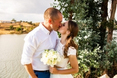 Bride and groom with beautiful photo backdrop water view