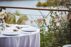 Wedding waterfront deck decorated with bunting