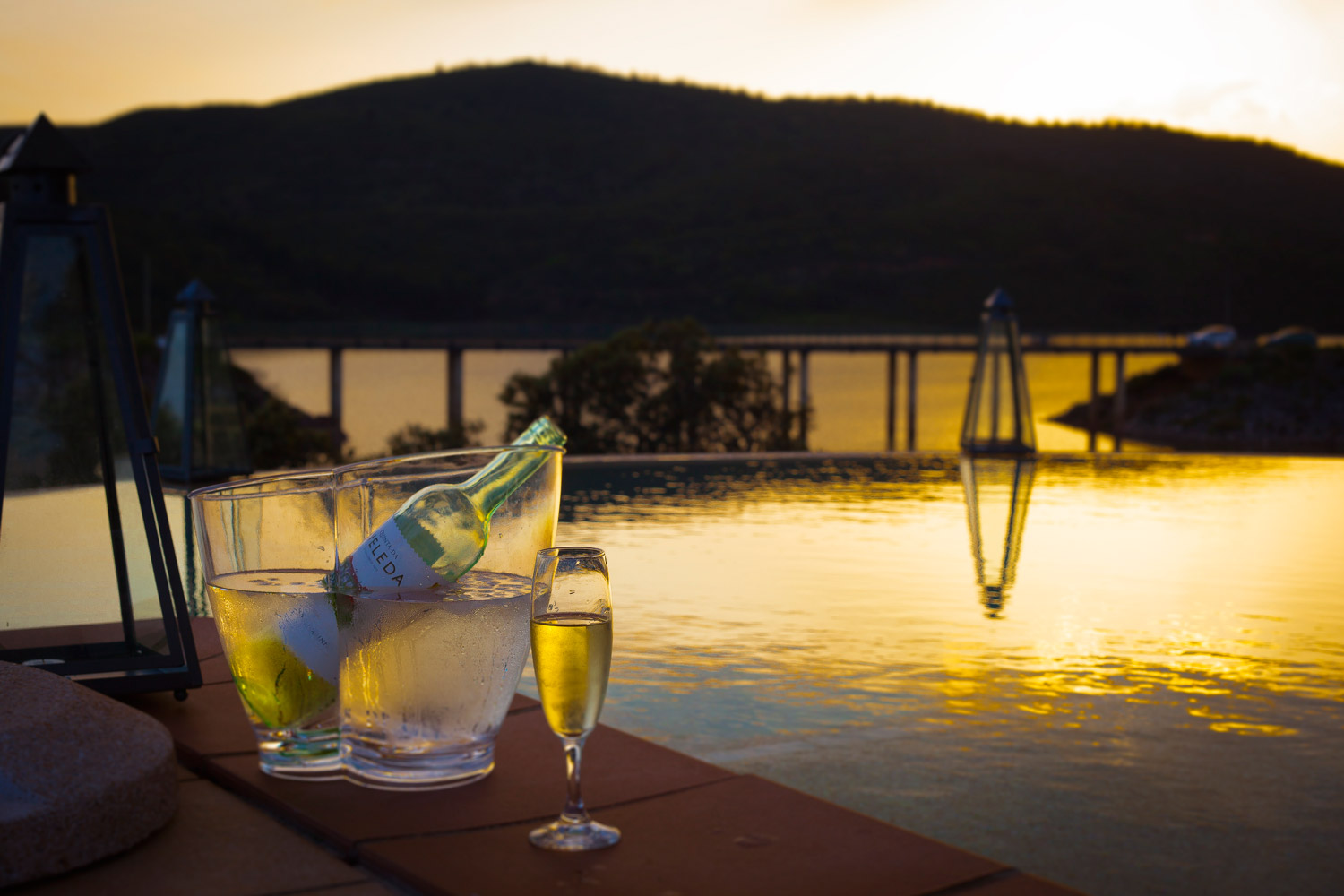 Sunset by the infinity pool with views of the river and mountains in the Algarve, Portugal