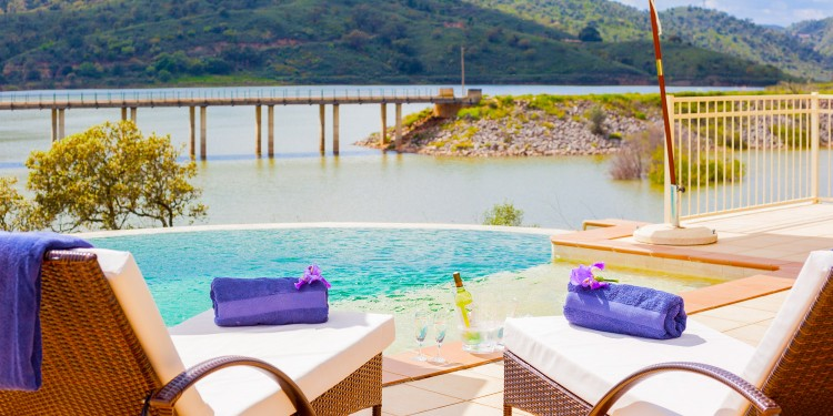 Outside seating | sun beds | with views of the river and pool | algarve, portugal