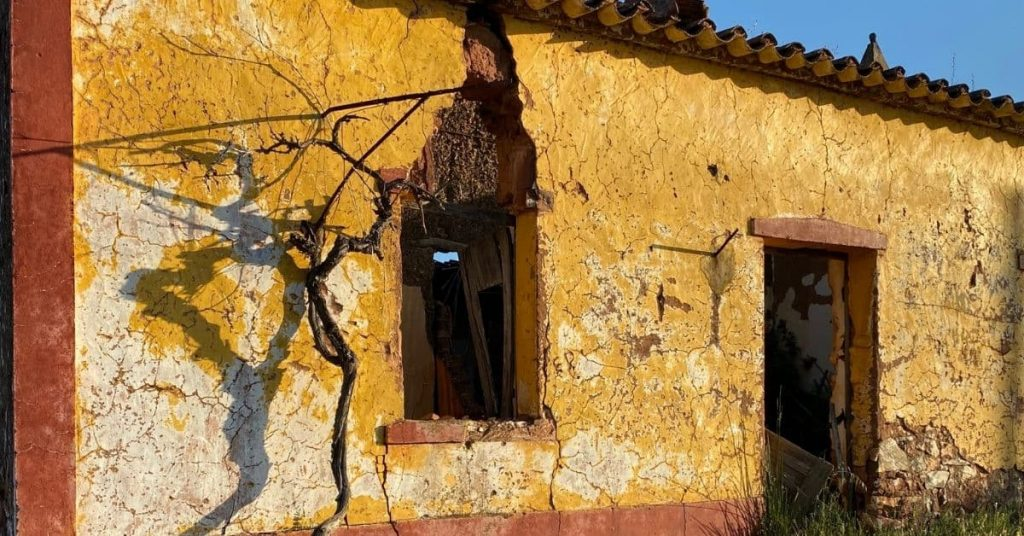 yellow algarve country ruin on the walk
